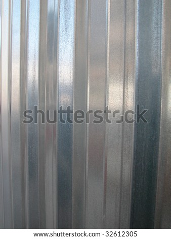 Galvanized zinc striped metal wall as a background