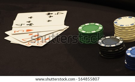 Gambling chips and cards.