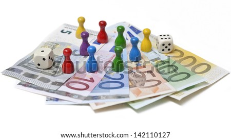Game pieces on money on a white background