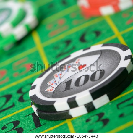Gaming chips on the green cloth casino. High detailed photo