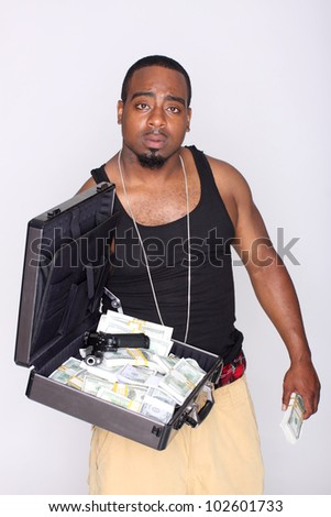 Gangster with a briefcase of cash and a gun.