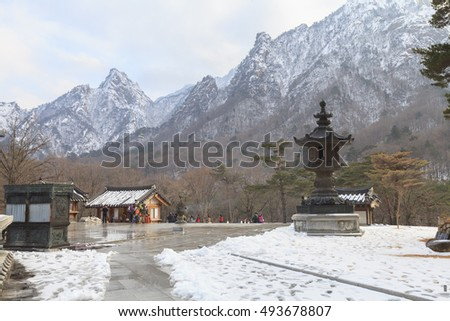 GANGWON, SOUTH KOREA -DEC 16, 2012: Sinheungsa Temple on the slopes of Mt.Seoraksan, Gangwon, Korea. Tourists hiking Seoraksan up to Ulsanbawi peak in Seoraksan National Park must pass this temple.