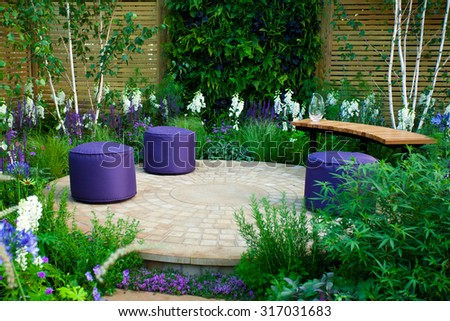 Garden landscape with a bench and seats