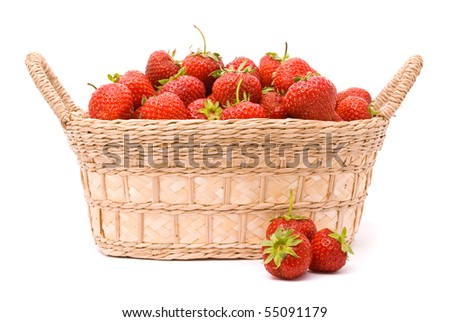 Garden Strawberries in wooden basket isolated on white