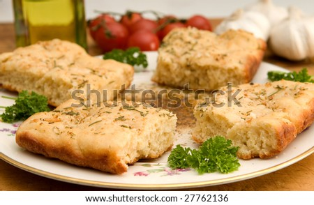 garlic and rosemary-topped focaccia with herbed olive oil