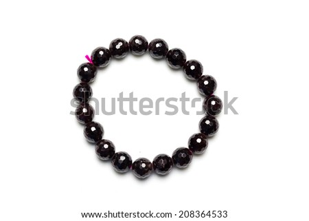 Garnet bracelet on white background