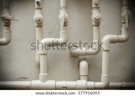 gas pipe in front of residential building wall