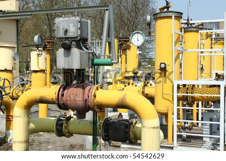 Gas pipeline. Yellow steel pipes. Industrial area detail.