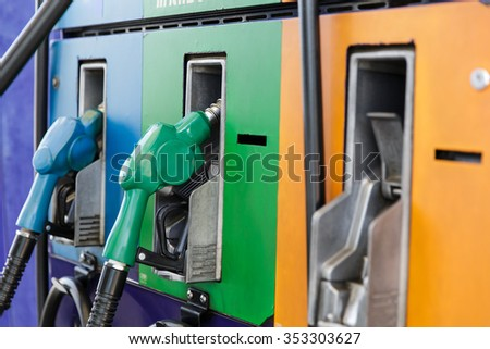 Gas pump nozzles in a service station