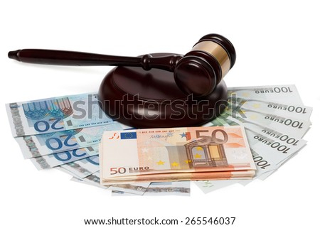 Gavel and banknotes on white background