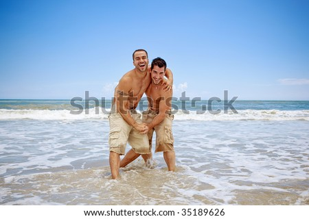 Gay couple on vacation at the beach