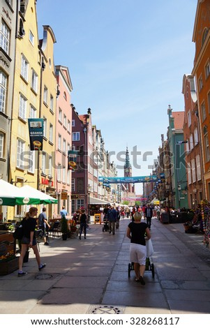 GDANSK, POLAND - MAY 23, 2012: People walking on a street with restaurants and shops in the city center