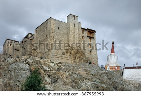 General view of the Leh Palace on the background of cloudy sky - Leh, Ladakh, Tibet, Jammu and Kashmir, Northern India