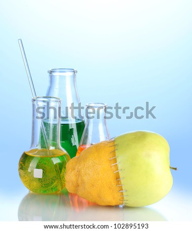 Genetically modified fruits on blue background