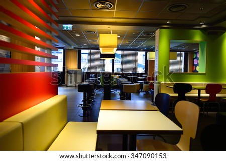 GENEVA, SWITZERLAND - NOVEMBER 19, 2015: McDonald's restaurant interior. McDonald's is the world's largest chain of hamburger fast food restaurants, founded in the United States.