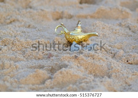 genie lamp in the sand