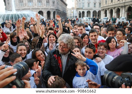 GENOA, ITALY - DEC 4: A group of unidentified people gather in De Ferrari square with comedian-actor Beppe Grillo to remember the six victims of the recent flood on Dec 4, 2011 in Genoa, Italy.