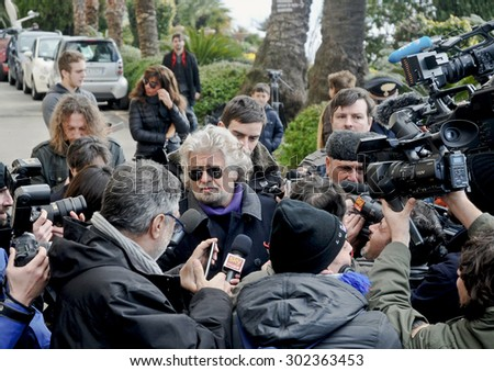 GENOA, ITALY - FEBRUARY 25, 2013: The leader of the Movement 5 Stelle of Beppe Grillo, surrounded by the press immediately after the electoral vote in Sant 'Ilario, district of Genoa Nervi.
