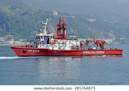 Genoa, Italy - may 20, 2014 - A patrol boat of the fire moves in the sea of Arenzano, near the spot where the wreck of the tanker Haven.