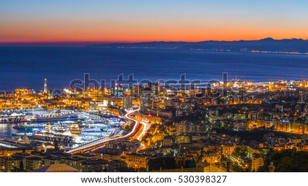 GENOA, ITALY, OCTOBER 27, 2016 - Aerial view of Genoa, Italy, the harbor with the causeway by night / Genoa, October 27, 2016 Italy, Europe