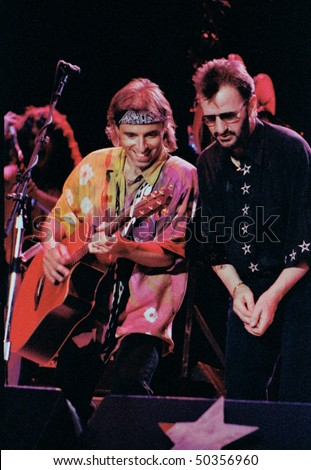 GEORGE WA - AUG 1: Guitar player Nels Lofgren with singer and drummer Ringo Starr performing on stage at The Gorge Amphitheater  August 1, 1992 in George, Wa.