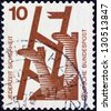 """GERMANY - CIRCA 1971: A stamp printed in Germany from the """"Accident Prevention"""" issue shows fall from ladder, circa 1971. - stock photo"""