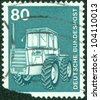 """GERMANY - CIRCA 1975: A stamp printed in Germany from the """"Industry and Technology"""" issue showing a farm tractor, circa 1975. - stock photo"""