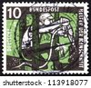 GERMANY - CIRCA 1957: a stamp printed in the Germany shows Miner with Drill, circa 1957 - stock photo
