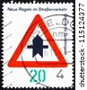 GERMANY - CIRCA 1971: a stamp printed in the Germany shows Proceed with Caution, new traffic rules, circa 1971 - stock photo