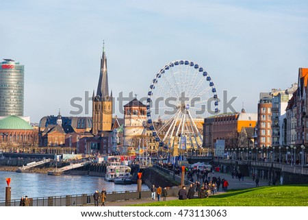 GERMANY, DÃ??SSELDORF - DECEMBER 26,2015:Giant wheel at the Burgplatz in Dusseldorf is part of the local christmas market