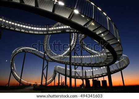 Germany, Duisburg - 06th October  - Tiger & Turtle sculpture on Magic Mountain at sunset, part of industry culture
