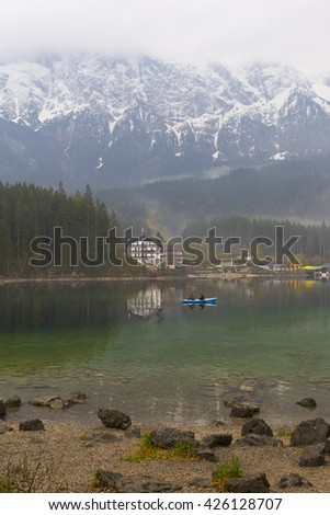 GERMANY -Eibsee ; 01 MAY 2016  ,Small islands on the Eibsee, Wetterstein mountains with Zugspitze and Waxenstein in the background.