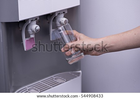 Getting a glass of refreshing water from the refrigerator.