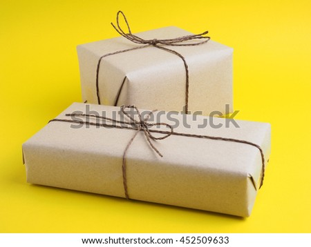Gift box in important day on yellow background concept.