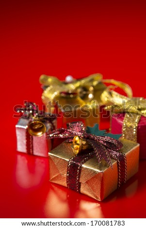 Gift box of Christmas on red background