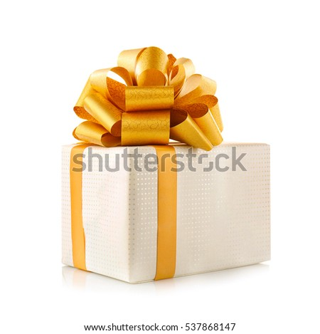 Gift box with golden ribbon bow isolated on white background