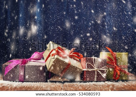 Gift boxes in snowfall, Christmas and New Year concept