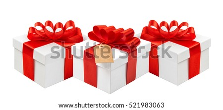Gift boxes with red ribbon bow and tag isolated on white background. Festive decoration.