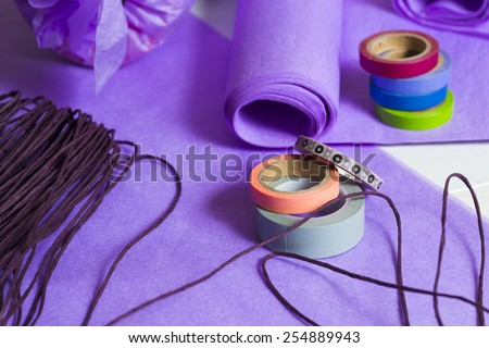 gift packaging with purple papers