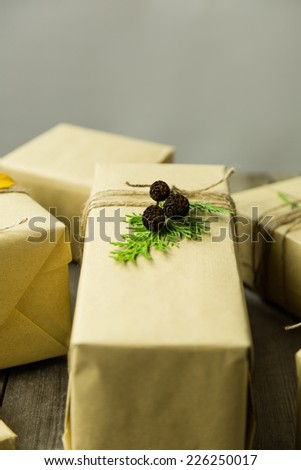 Gifts wrapped in kraft paper, tied with twine and embellished with natural details