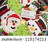 Gingerbread cookies decorations and colorful candies on a plate - stock photo
