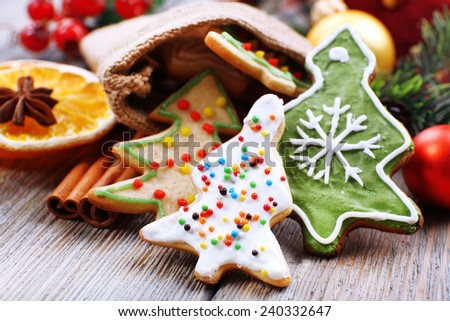 Gingerbread cookies with slices of orange, cinnamon and star anise on wooden table background