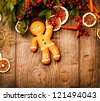 Gingerbread Man over Wood. Christmas Holiday Background. - stock photo