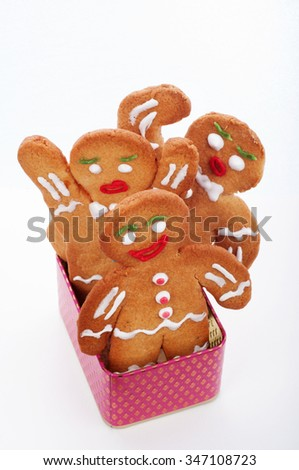 Gingerbread men in a pink box on a white background. Isolated object. Top view