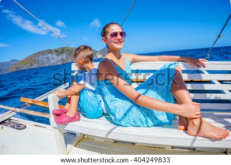 Girl and boy on a boat
