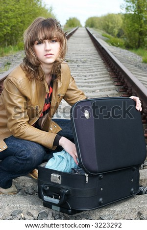 girl and holdall