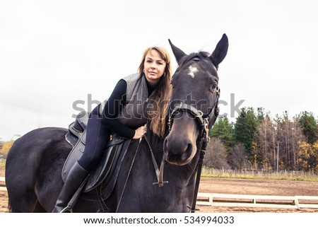 Girl and horse in an autumn day