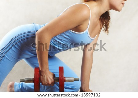 girl and red dumbbell
