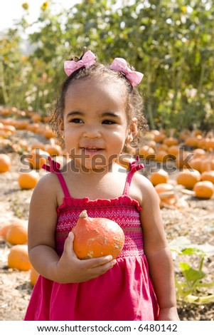 Girl at the pumpkin patch