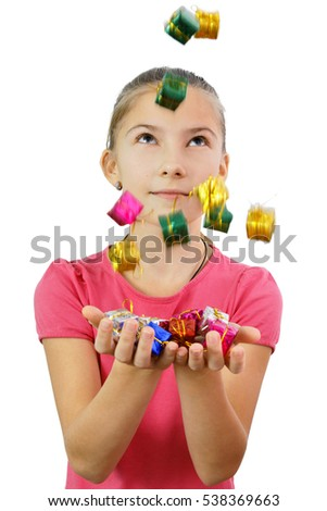 Girl catches gifts in the form of miniature colored boxes